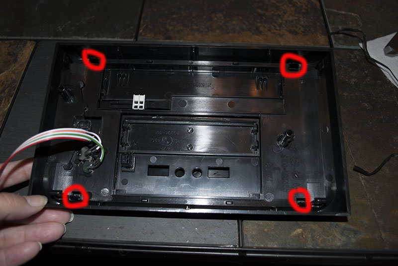 View of the four inside tabs of the front bezel.